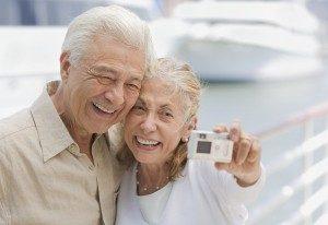 Senior Couple Using Digital Camera at Marina