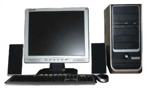 Un ejemplo típico de ordenador multimedia. La pantalla lleva altavoces incorporados y aparte, el equipo lleva altavoces externos para aumentar la calidad del sonido.