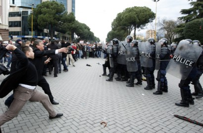 Albanian supporters of the opposition Socialist Party clash with police during an anti-government rally in Tirana