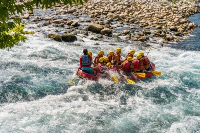 A group of people rafting on whitewater.